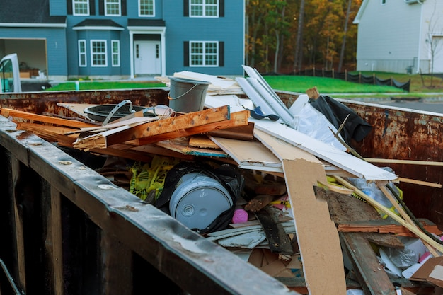 Roll-off dumpster filled with building rubble Premium Photo
