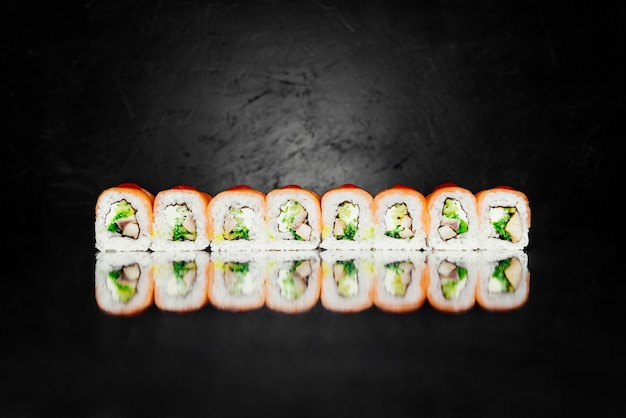 Roll red dragon made of smoked salmon, nori, pickled rice, cheese, uagagi perch Free Photo