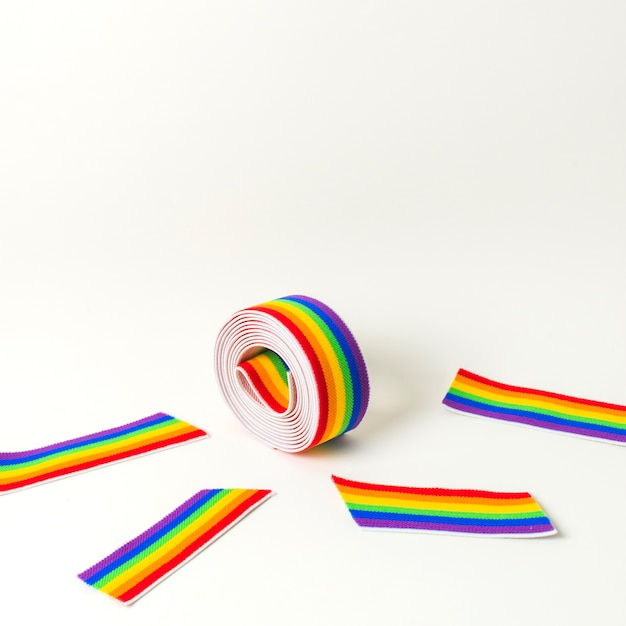 Roll of tape and ribbon in bright lgbt colors Free Photo