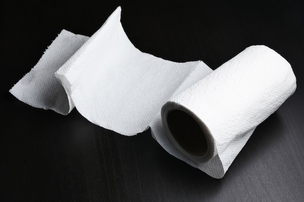 Roll of tissue paper on black background Premium Photo