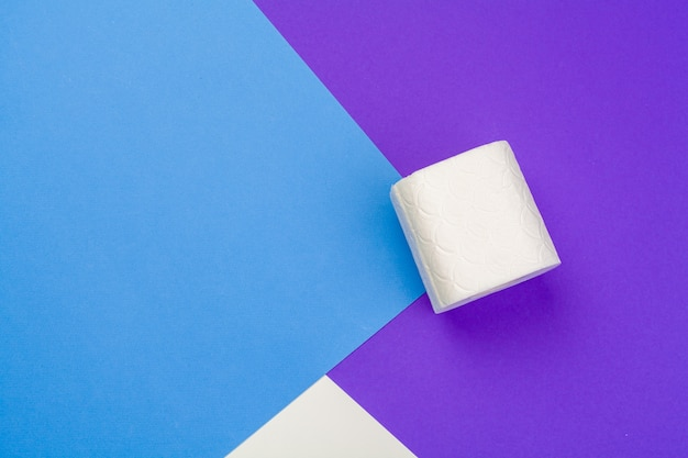 Roll of toilet paper on blue color Premium Photo