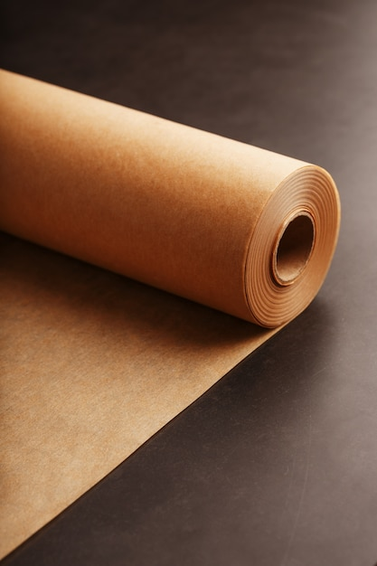 A roll of unfolded brown parchment paper, for baking food Premium Photo