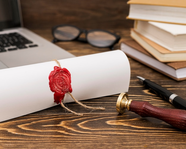 Rolled graduation diploma certificate Free Photo