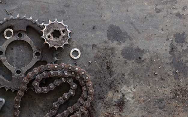 Roller chains with sprockets for motorcycles on old black  background. top view Premium Photo