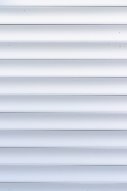 Roller shutter texture. background with metal stripes in white. iron roller shutters of white color. Premium Photo