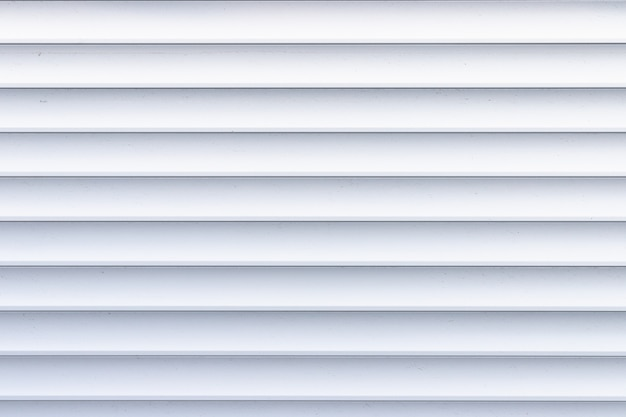 Roller shutter texture. background with metal stripes in white. Premium Photo