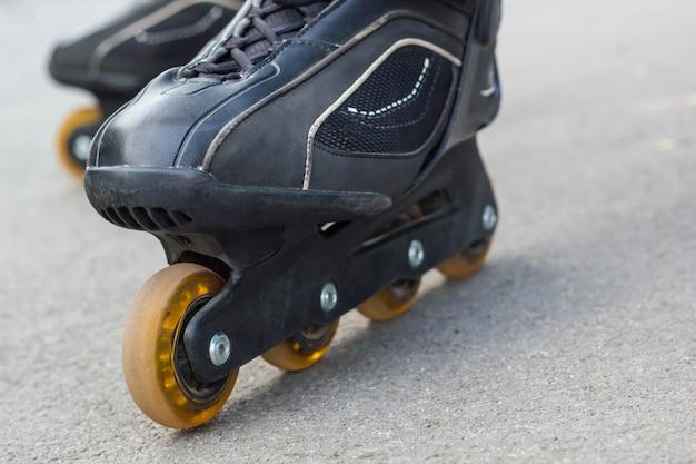 Roller skate on asphalt close-up Premium Photo