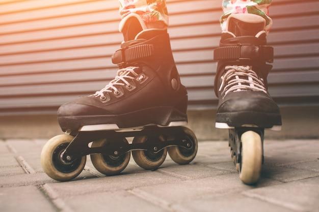 Roller skates outdoors. summer lifestyle portrait Premium Photo