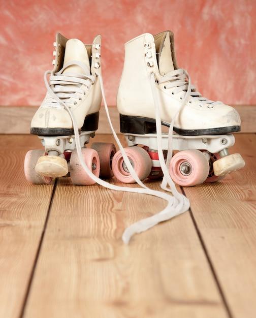 Roller skates on a wooden floor Premium Photo