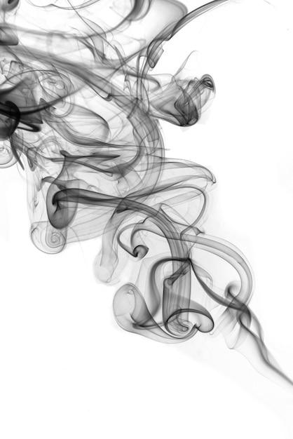 Rolling black smoke on white background Premium Photo