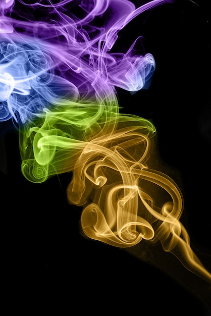 Rolling colorful smoke on black background Premium Photo