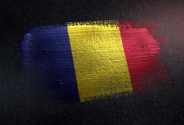 Romania flag made of metallic brush paint on grunge dark wall Premium Photo
