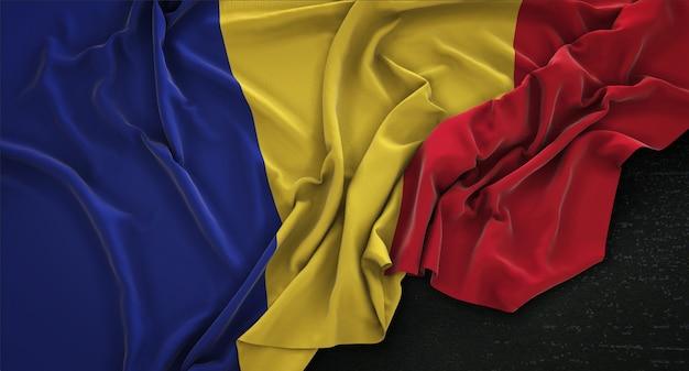 Romania flag wrinkled on dark background 3d render Free Photo