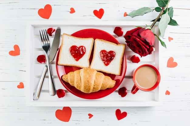 Romantic breakfast on light wooden tray Free Photo