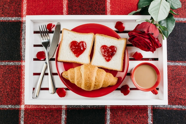 Romantic breakfast on white tray on table Free Photo
