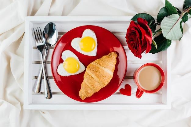 Romantic breakfast on white tray Free Photo