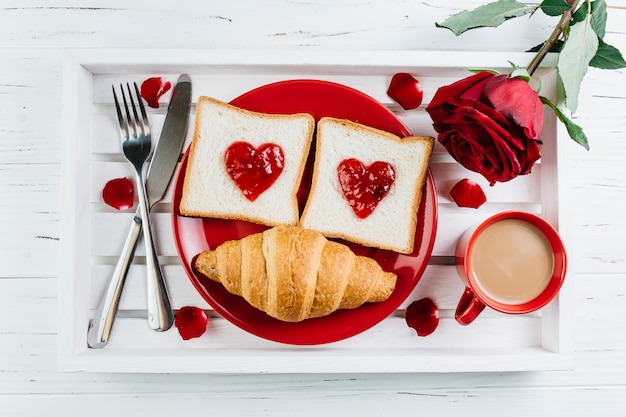 Romantic breakfast on white wooden tray Free Photo