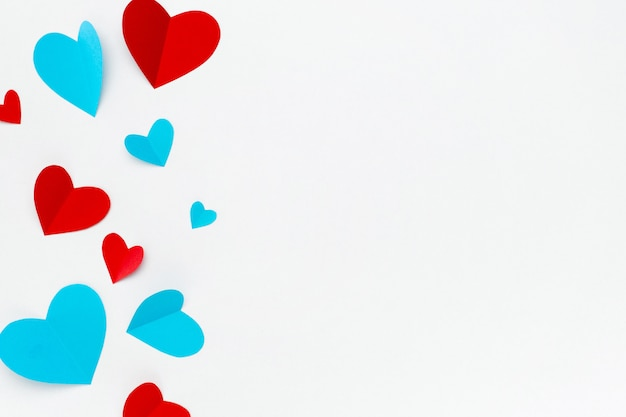 Romantic composition made with red hearts on white background with copyspace for text Free Photo