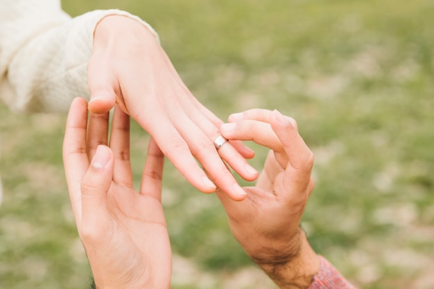 Romantic couple getting engaged Free Photo