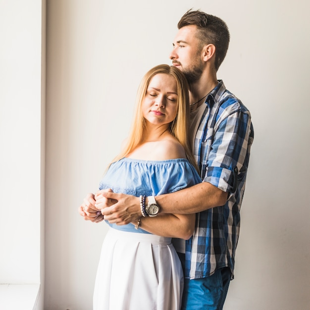 Romantic couple hugging at home Free Photo