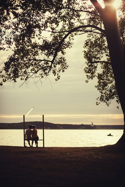 Romantic couple sitting on a bench Premium Photo