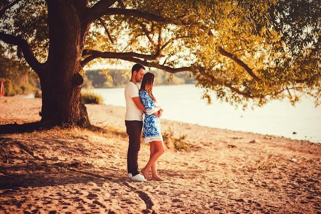 Romantic couple standing on the beach Premium Photo