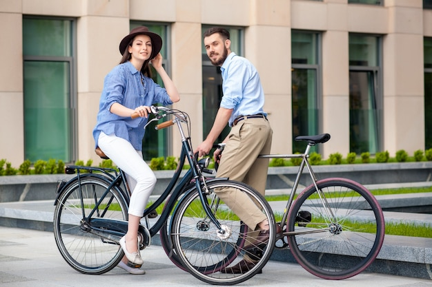 Romantic date of young couple on bicycles Free Photo