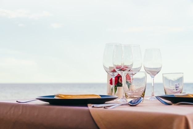 Romantic dining table setting with wine glass and other Free Photo