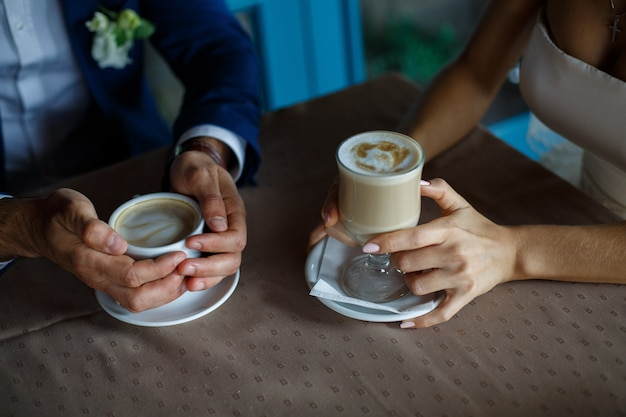 Romantic dinner close up. romantic moment in cafe. man and woman talking over coffee. couple in love at romantic date in restaurant. meeting at a coffee table Premium Photo