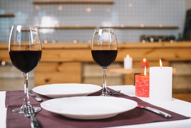 Romantic dinner table with wine glasses Free Photo