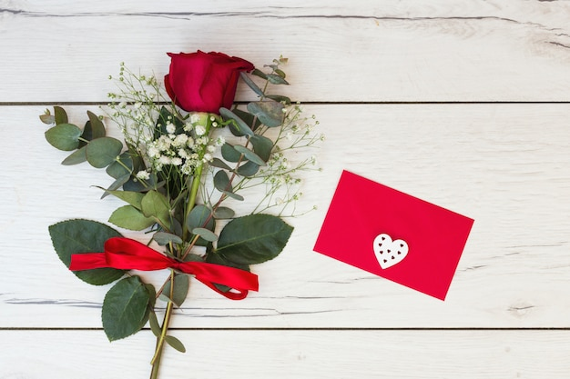 Romantic greeting card with red rose Free Photo