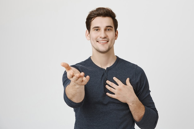 Romantic handsome boyfriend confessing love, pointing Free Photo