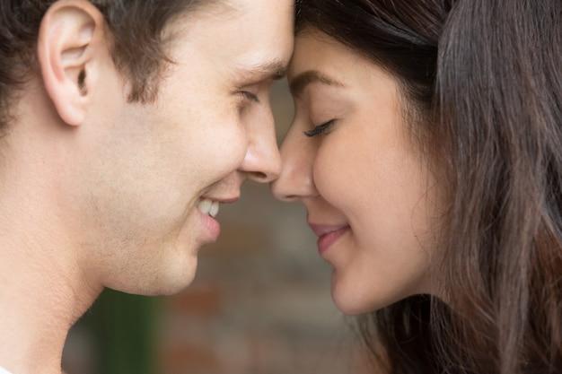 Romantic happy sincere couple face to face close up portrait Free Photo