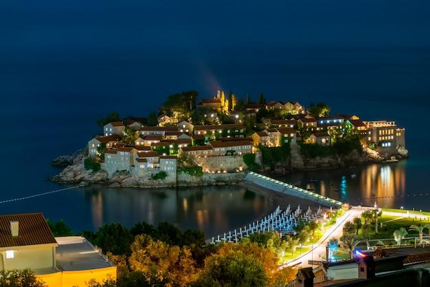 Romantic island of sveti stefan glow in the night with the moonlight Premium Photo