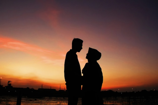 Romantic moments of two couples under the sky with sunset Premium Photo