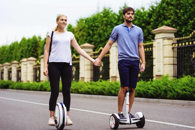 Romantic relationships. pair gyroboard monowheel. Premium Photo
