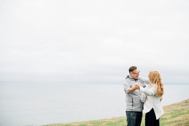 Romantic senior couple dancing outdoors Premium Photo