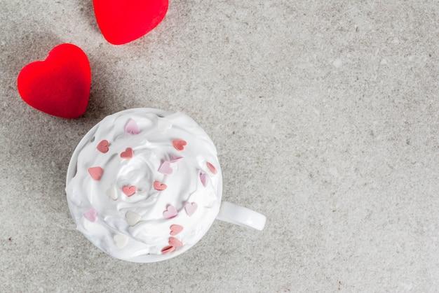 Romantic valentine's day ice cream on grey concrete with hearts Premium Photo