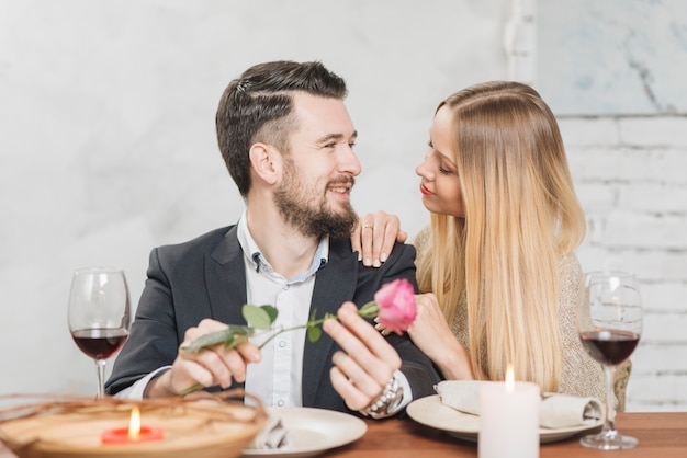 Romantic woman and man at table Free Photo