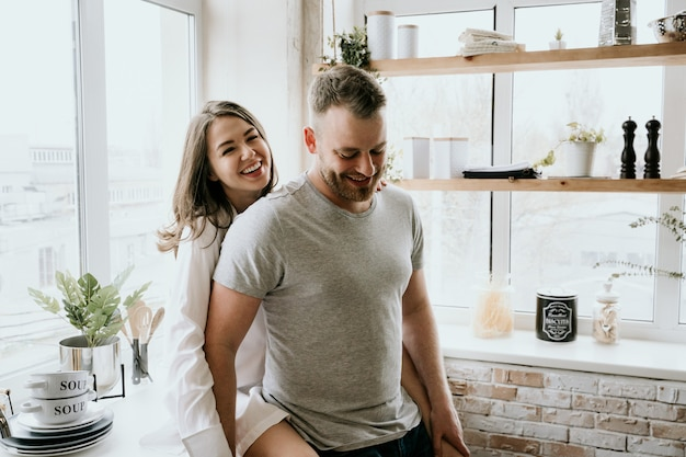 Romantic young couple cooking together in the kitchen Premium Photo