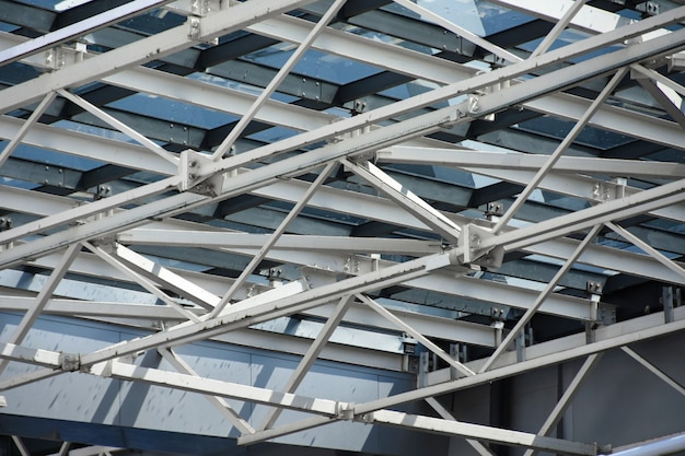 A roof made of large metal structures and a glass of a modern building Premium Photo