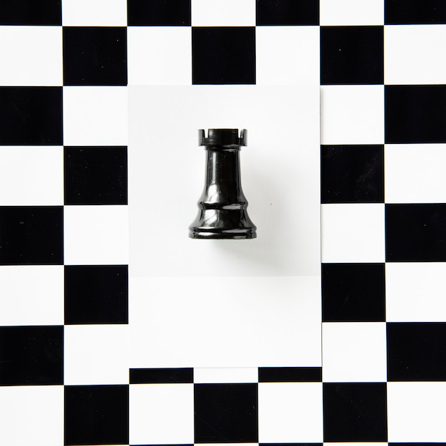 Rook chess piece on a pattern Free Photo