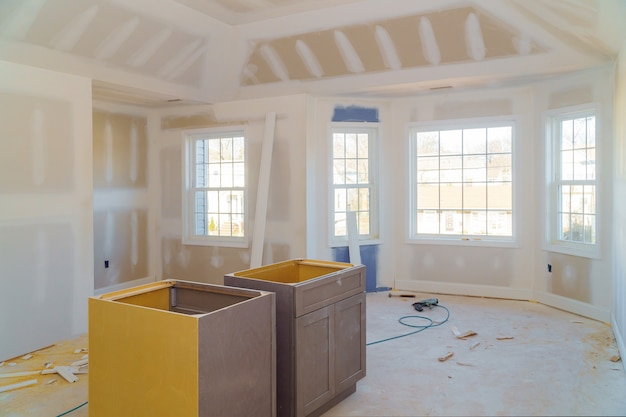 Room drywalls with plasterboards at a under construction Premium Photo