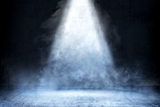 Room with concrete floor and smoke with light from the top, background Premium Photo