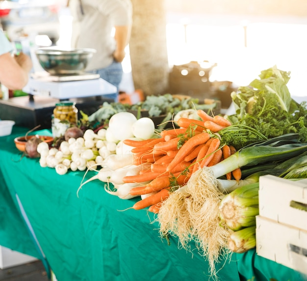 Roots vegetable on table for sale at grocery store market Free Photo