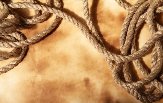 古い紙の背景にロープ 無料写真