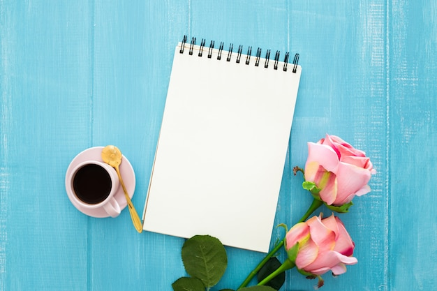 Roses, coffee and notebook Free Photo