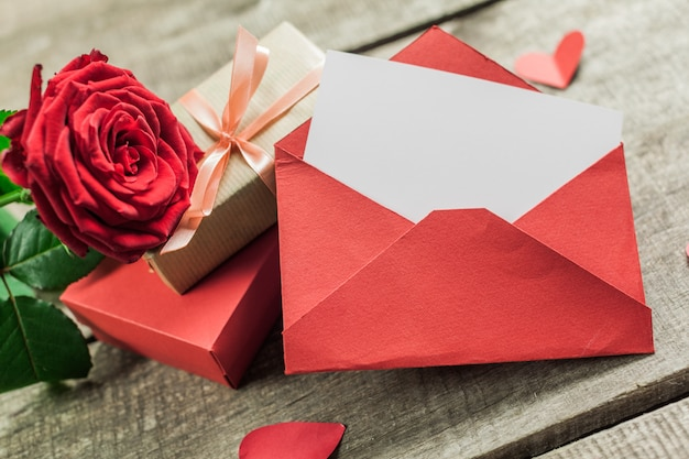 Roses and a hearts on wooden board, valentines day Premium Photo