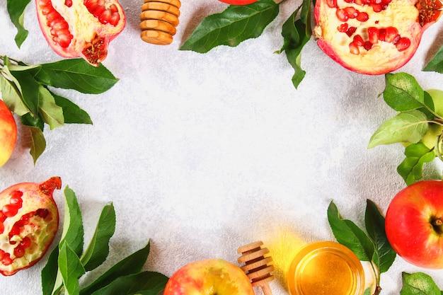 Rosh hashanah jewish new year holiday concept.  apples, honey, pomegranate. copy space. to Premium Photo