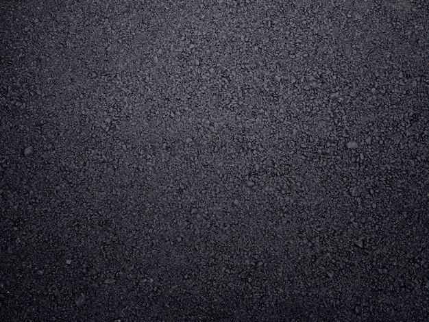 Rough asphalt road textured. Premium Photo